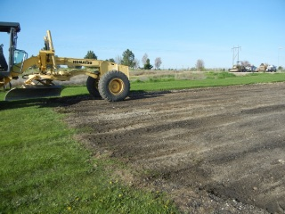 Grading the new runway bedding in April 2012