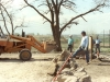 Placing rocks to protect the well area