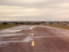 Runway looking west while sprinkler are being tested.